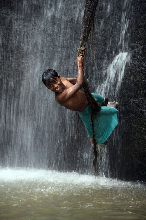 monsoon boy enjoying rains india